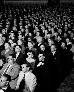 UNITED STATES - 1952: Full frame of movie audience wearing special 3D glasses to view film Bwana Devil which was shot with new natural vision 3 dimensional technology. (Photo by J. R. Eyerman/Life Magazine/The LIFE Picture Collection/Getty Images)
